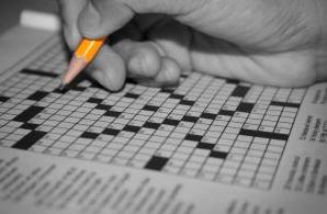 toast holder crossword clue